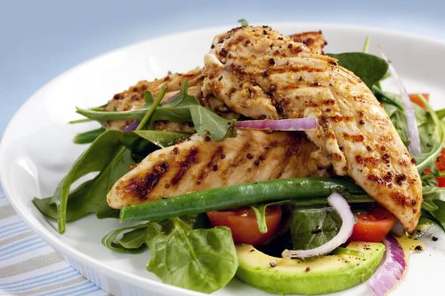 Grilled chicken tenderloins with avocado, tomatoes, red onion, green beans, spinach and arugula