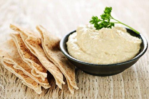 Hummus dip with pita bread slices