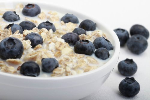 No added sugar muesli with semi-skimmed milk and blueberries