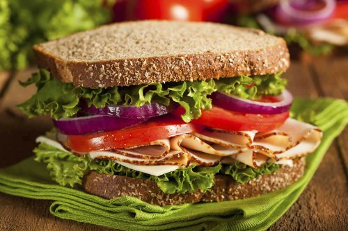Turkey sandwich with lettuce, tomato and onion